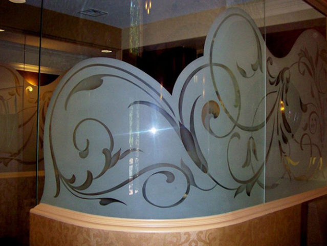 iron-scroll-design-curved-glass